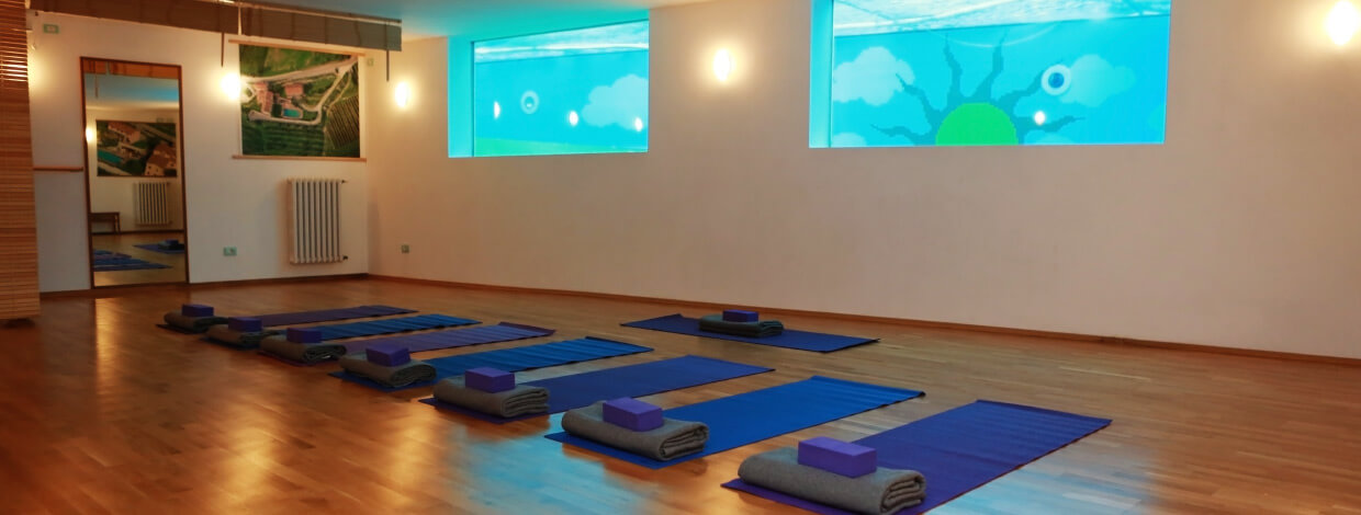 yoga in italy indoor yoga room manduka props