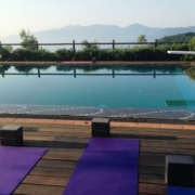 Yoga in Italy - Practice outdoors by the pool