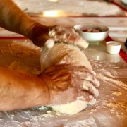 Yoga in Italy Cooking Class showing experienced hands making of dough for potato gnocchi. Yoga Retreat Italy