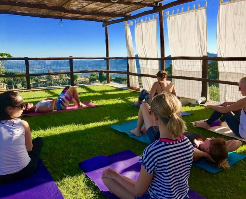 Yoga in Italy afternoon yoga practice up at panoramic outdoor yoga platform